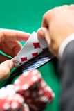 Gambler checking his poker cards Royalty Free Stock Photography