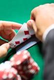 Gambler checking his poker cards Royalty Free Stock Photography
