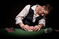 Gambler checks the cards Royalty Free Stock Photo