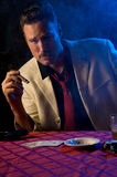 Gambler/gangster in smoky room Stock Photo