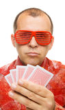 Gambler holding playing cards Stock Photography