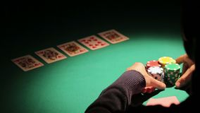 Gambler making all-in bet, taking strategic step to raise bank, win more money. Stock footage stock footage