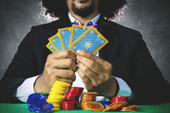 Gambler playing cards and bet with chip Stock Image