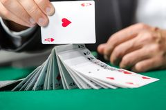 Gambler playing with poker cards Royalty Free Stock Photos
