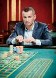 Gambler playing roulette at the casino table Royalty Free Stock Photo