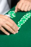 Gambler puts the poker chips on the table Royalty Free Stock Photo