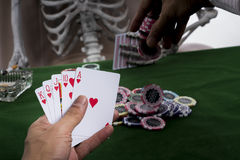 Gambler is putting chips into stacks of bets Royalty Free Stock Image