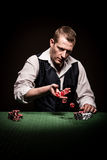 Gambler rolls the dice Stock Photography