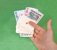 Gambler's hand with four aces on green table Royalty Free Stock Photography