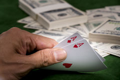 The gambler show revealing blackjack in hand. The Hands show chance of winning blackjack game and a pile of dollars on the table at casino royalty free stock images