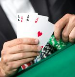 Gambler shows cards 4 aces Royalty Free Stock Photography