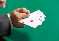 Gambler shows playing cards 4 aces Royalty Free Stock Images