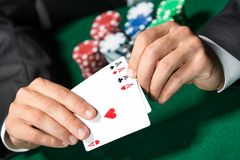 Gambler shows poker cards 4 aces Royalty Free Stock Image