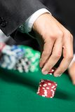 Gambler stakes the pile of poker chips Stock Photos