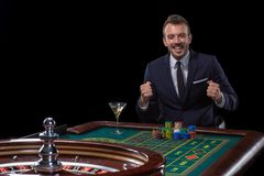 Gambler stakes playing at the roulette table. Risky entertainment of gambling stock photos