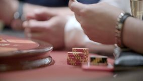 Gamblers in Casino. Hands of unidentified people playing poker in the casino, roulette in slow motion. Gambling, addiction concept stock video footage
