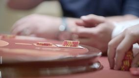 Gamblers in Casino. Hands of unidentified people playing poker in the casino, roulette in slow motion. Gambling, addiction concept stock video