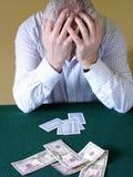 Gamblers Despair. Card Player with Head Held in Hands Stock Photos