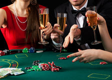 Gamblers drinking champagne Royalty Free Stock Photography