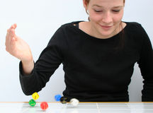 Gambling. A confident teenager throwing colorful dice Stock Photography