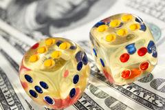 Gambling. Two dices with several one hundred dollar bills stock photography