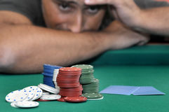 Gambling. Stressed man in a poker table gambling stock photo