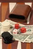 Gambling. Board and US dollar bills Stock Photo
