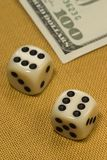 Gambling. Dice with number six and the money in background Royalty Free Stock Photography