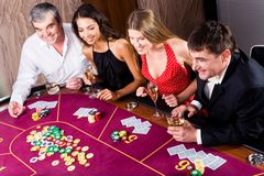 Gambling. Portrait of people sitting at the table and gambling royalty free stock photos