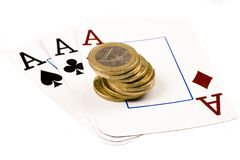 Gambling. 3 aces and a stack of euro coins on a white background Stock Photography