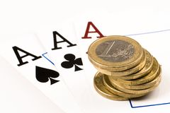 Gambling. 3 aces and a stack of euro coins on a white background Royalty Free Stock Photos