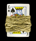 Gambling addiction. The king is the gambler... The rope is his addiction... And he cant escape Royalty Free Stock Photos