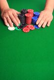 Gambling it all. Betting stacks of casino chips or cashing out winnings with copy space Stock Photography