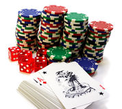 Gambling attributes. Chips with dices and cards isolated over white Royalty Free Stock Photography
