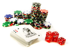 Gambling attributes. Chips with dices and cards isolated over white Royalty Free Stock Photo