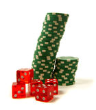 Gambling attributes. Poker chips with dices isolated over white Royalty Free Stock Images
