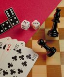 Gambling background on a chess gaming table. Stock Image