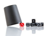 Gambling background with dice and dice cup Stock Photography
