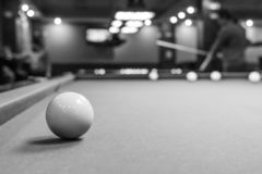 Gambling Billiards. The game of American and Russian billiards. Pool table, ball and cue. Sports leisure. Friendly tournament. Winter fun. Green cloth in royalty free stock photo