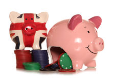 Gambling in Britain piggybank. Cutout Royalty Free Stock Images