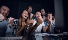 Gambling business team looks at the computer monitor stock photography