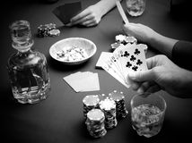 Gambling at the card table Stock Photos