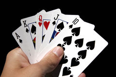Gambling Cards In Hand. Left Hand Holding Gambling Cards - Poker Card Suit - Queen Of Hearts Plus Spades Royalty Free Stock Images