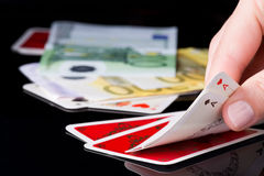 Gambling cards and money Stock Image