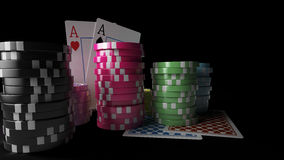 Gambling casino chips with playing cards on the dark background. 3D render of gambling casino chips with playing cards on the dark background. There are four Royalty Free Stock Image