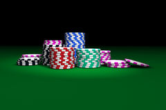 Gambling Casino Chips. Stacked on green table. Great background for poker magazines, banners, webpages, flyers, etc Royalty Free Stock Photo