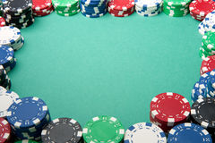 Gambling Chip Border on Green. A number of gambling chips create a border on some green felt stock photo
