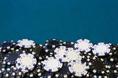 Gambling chip frame. Poker chip frame or border with blue card table velvet Royalty Free Stock Photography