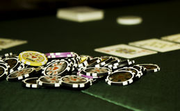 Gambling chip. Green table with gambling chips Royalty Free Stock Photography