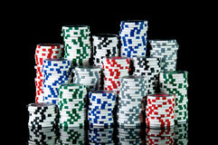 Gambling Chips. Rows of casino chips on black background Stock Photography